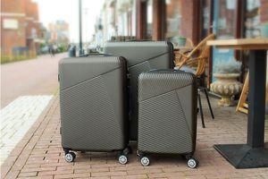 Grijze 3-delige kofferset met combinatieslot